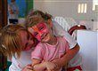 Face painted child with Nanny